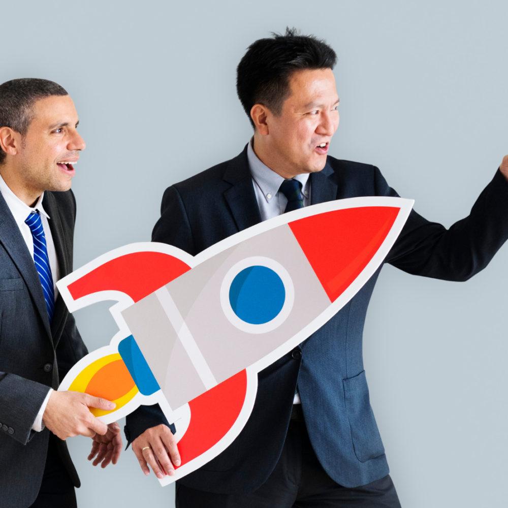 businessmen-holding-launching-rocket-icon